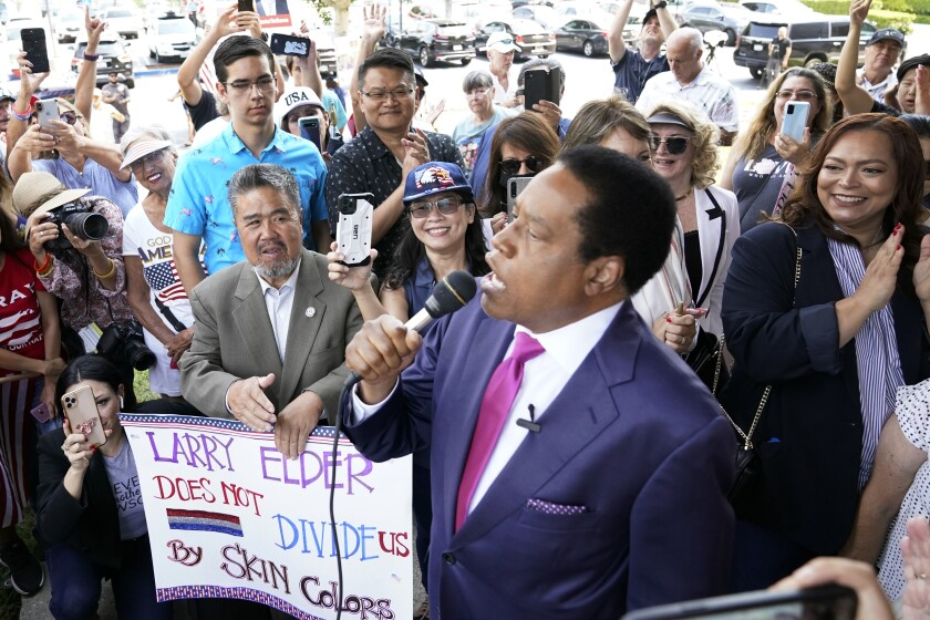 Talk show host Larry Elder addresses supporters at a campaign stop as he runs for governor in the recall election.