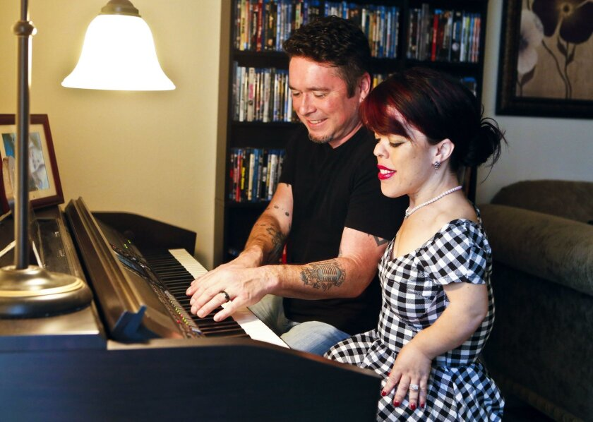 """Briana Renee Kealiher, a co-star of """"Little Women: LA,"""" married Matt Ericson in April. The couple's first date was in front of cameras for the reality show. Here, they play and sing music together at their condominium in Bonsall."""