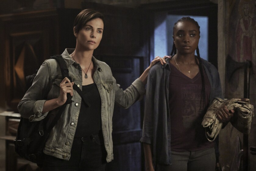 "Charlize Theron and Kiki Layne in ""The Old Guard."""