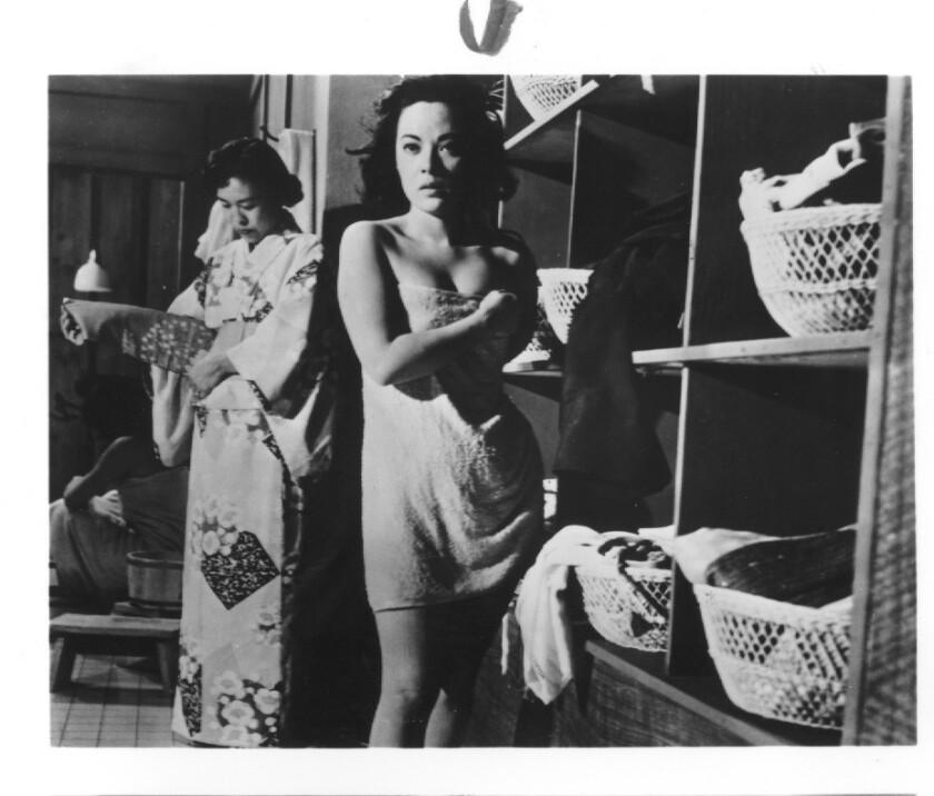 "Actress Yoshiko ""Shirley"" Yamaguchi wraps up in the 1955 film noir ""House of Bamboo."""