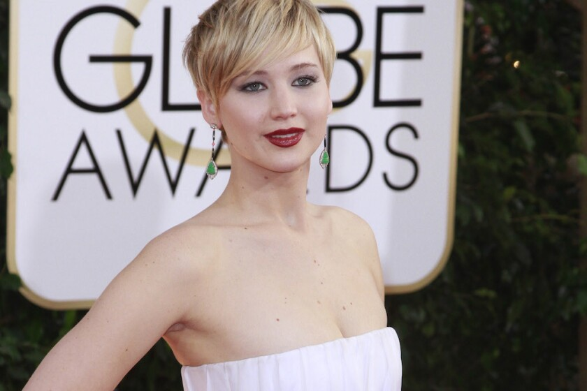 Jennifer Lawrence arrives for the 71st Golden Globe Awards show at the Beverly Hilton Hotel.
