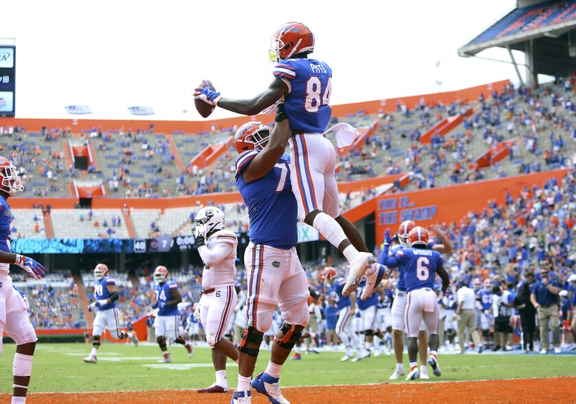 Florida tight end Kyle Pits (84) leaps up as he celebrates a touchdown catch with teammates during an NCAA college football game against South Carolina in Gainesville, Fla., Saturday, Oct. 3, 2020. (Brad McClenny/The Gainesville Sun via AP, Pool)