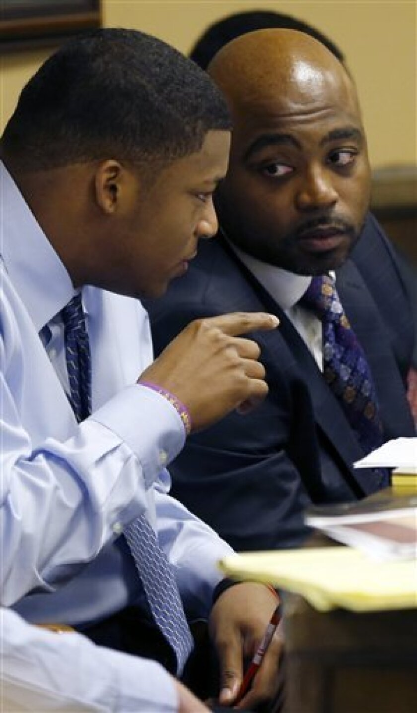 Ma'lik Richmond, 16, left, talks defense attorney Walter Madison during testimony at Richmond and co-defendant Trent Mays (not shown) trial on rape charges in juvenile court on Thursday, March 14, 2013 in Steubenville, Ohio. Mays and Richmond are accused of raping a 16-year-old West Virginia girl in August of 2012. (AP Photo/Keith Srakocic, Pool)