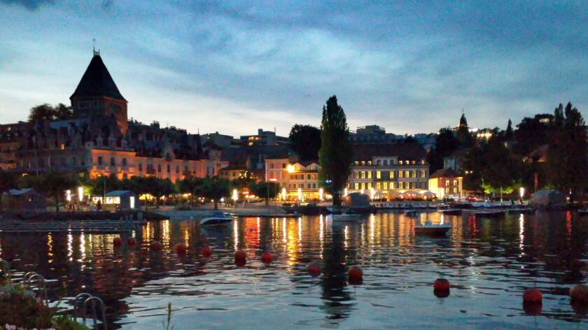 Twilight view of the lakeside promenade in Lausanne, Switzerland.