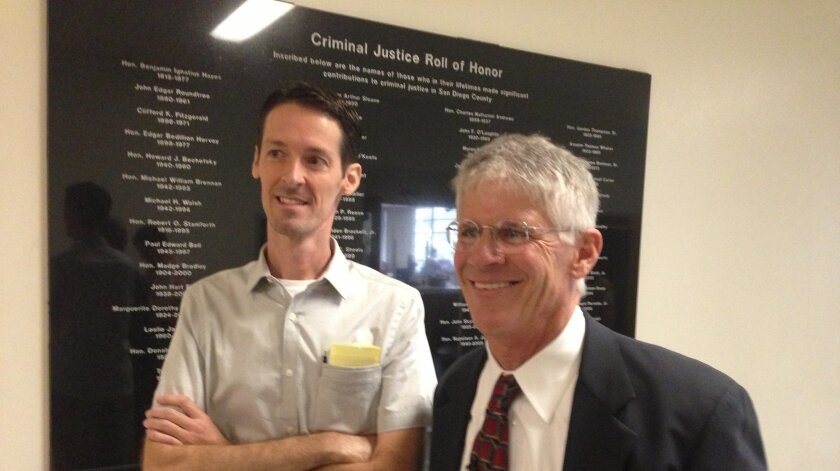 Jeff Olson, left, with attorney Tom Tosdal after the verdict in San Diego's sidewalk chalk vandalism case.