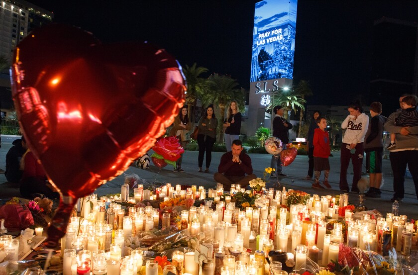 Mourners pay tribute to the Las Vegas shooting victims in October 2017.
