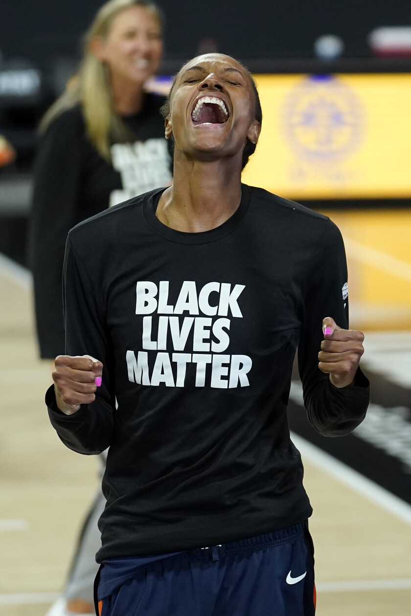 Connecticut Sun forward DeWanna Bonner celebrates after her team defeated the Los Angeles Sparks during a WNBA playoff basketball game Thursday, Sept. 17, 2020, in Bradenton, Fla. (AP Photo/Chris O'Meara)