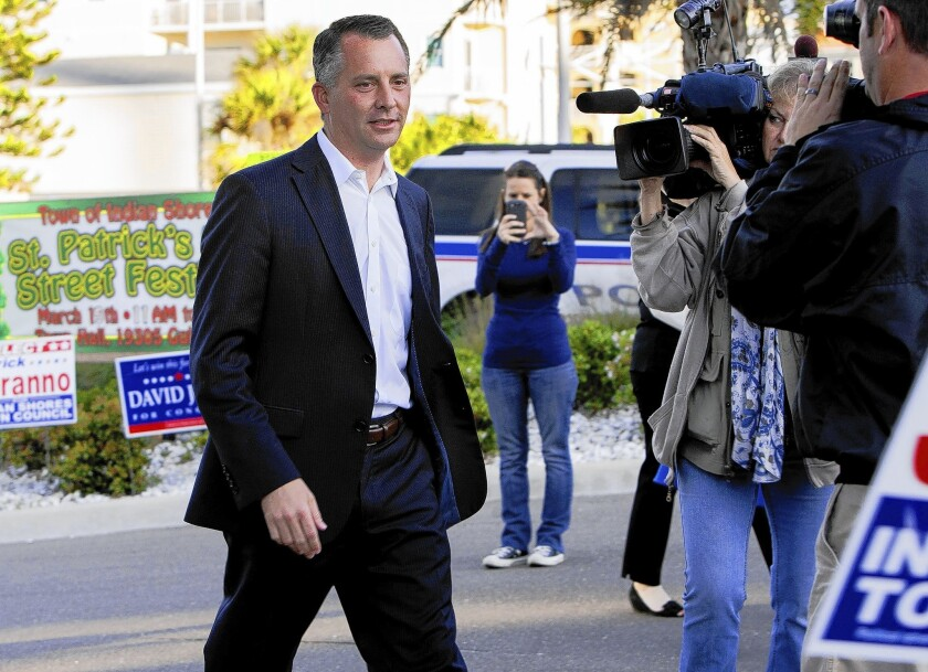 Republican candidate David Jolly arrives to vote at a polling station in Indian Shores, Fla. He defeated Alex Sink to represent a Gulf Coast congressional district.