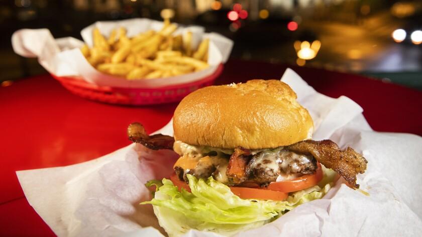 LAHAINA, HAWAII-MARCH 20, 2019: The Luna Burger, $13.99, shown with optional gluten free bun, $2, a
