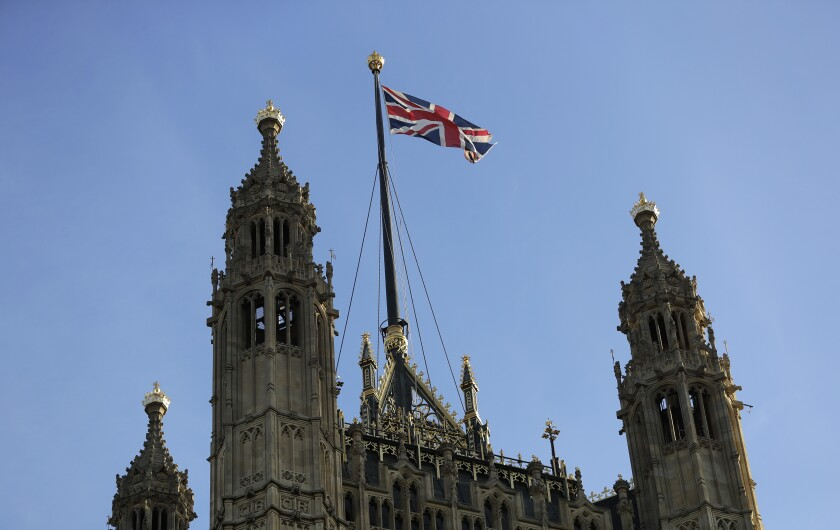 The Union Jack flies above Britain's House of Lords in London in August. An analysis found that ethnic minorities have a significantly heightened risk of COVID-19-related death compared with those who identified themselves as white.