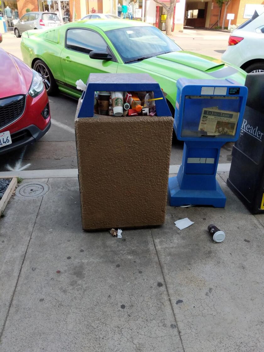 Photo taken at 1:20 p.m. Saturday, Feb. 17 on Girard Avenue. It is very disappointing to see the neglect with which City Services treats our Village of La Jolla neighborhood. Public trash cans should have been emptied on Friday, or if not then, certainly today! They will not be emptied until Tuesday (after Presidents' Day weekend), so the area around them will be overflowing with trash and garbage. — Submitted by Gerhard Bendl
