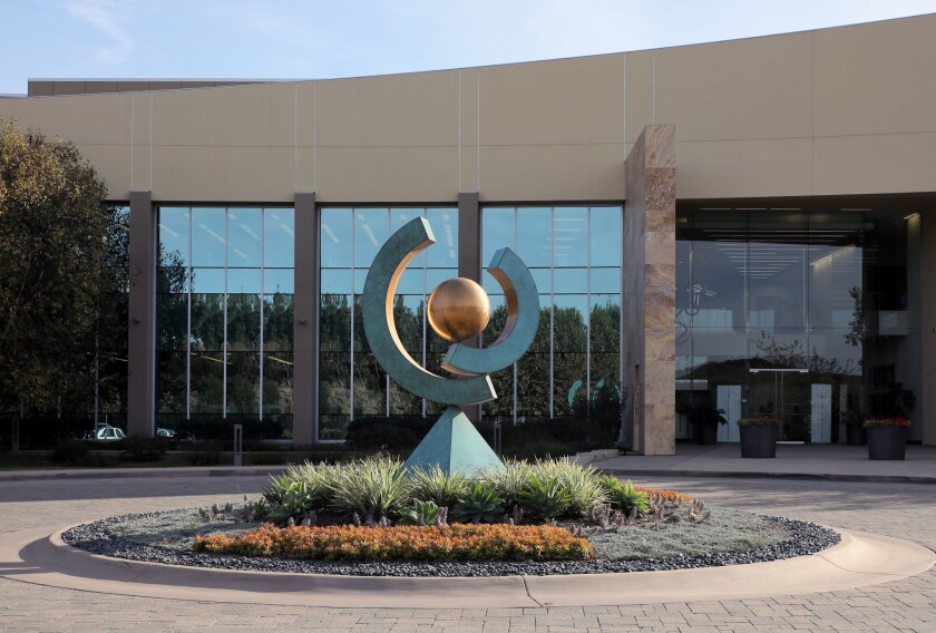 A large sculpture stands in front of the main entrance to Ionis Pharmaceuticals in Carlsbad.