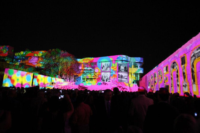 """The Getty's classic curves are bathed in light for """"The Moment"""" during the Pacific Standard Time: Art in LA 1945-1980 opening event."""