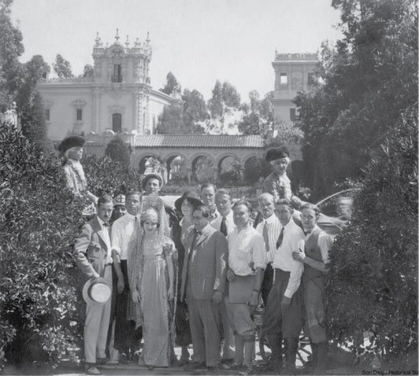 """Mary Pickford (front left) and director Ernst Lubitsch (in suit in center) were joined by cast and crew members of """"Rosita,"""" which was filmed in Balboa Park in 1923."""