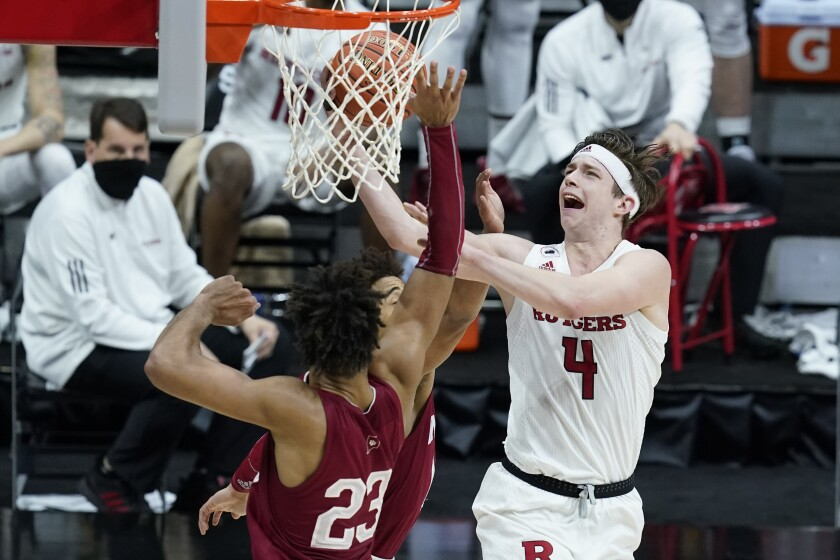 Rutgers' Paul Mulcahy (4) puts up a shot against Indiana's Trayce Jackson-Davis (23) during the second half of an NCAA college basketball game at the Big Ten Conference tournament, Thursday, March 11, 2021, in Indianapolis. (AP Photo/Darron Cummings)