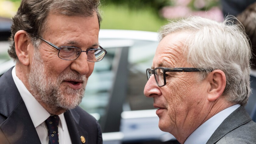 Spanish Prime Minister Mariano Rajoy, left, speaks with European Commission President Jean-Claude Juncker after an EU summit in Brussels on Wednesday, June 29, 2016.