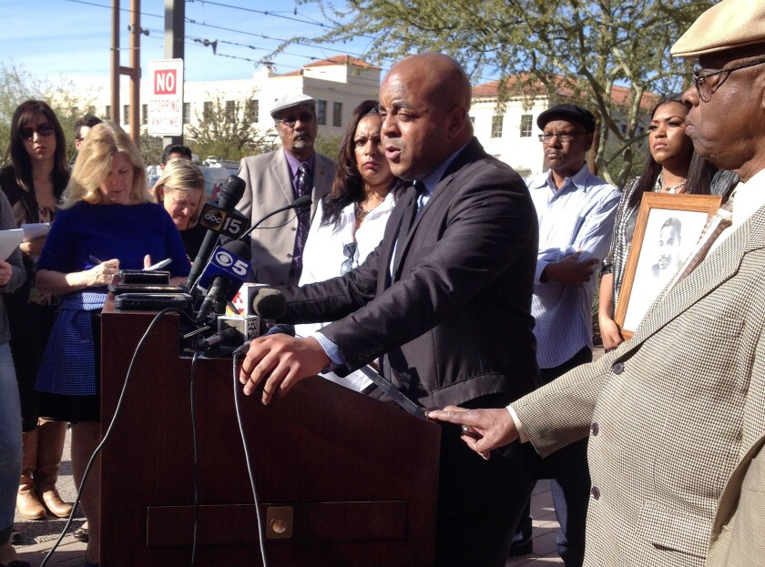 The Rev. Jarrett Maupin, center, an Arizona civil rights activist, at a news conference in Phoenix on Tuesday.
