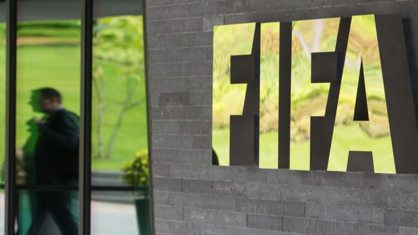FIFA's logo appears at the entrance to the organization's headquarters in Zurich on May 27.
