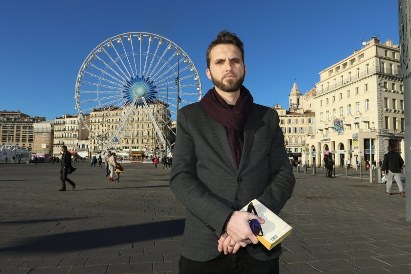 In this Wednesday, February 2, 2016 Imam Ludovic-Mohamed Zahed, poses on the Old-Port, in Marseille, southern France. A gay imam from Algeria is working with an LGBT association in Marseille to counsel and protect young gay Muslims who make their way to the ancient port city. The Le Refuge group sa