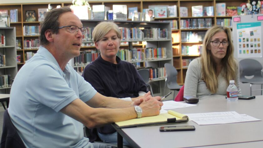 Cluster president John May (left) leads a discussion on budgeting, scheduling and more at the Cluster Association meeting, Feb. 16 at the Muirlands Middle School library.