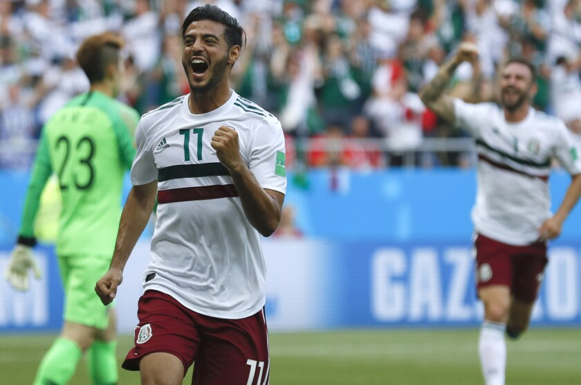 Mexico's Carlos Vela celebrates after scoring the opening goal during the group F match between Mexico and South Korea at the 2018 soccer World Cup in the Rostov Arena in Rostov-on-Don, Russia, Saturday, June 23, 2018.