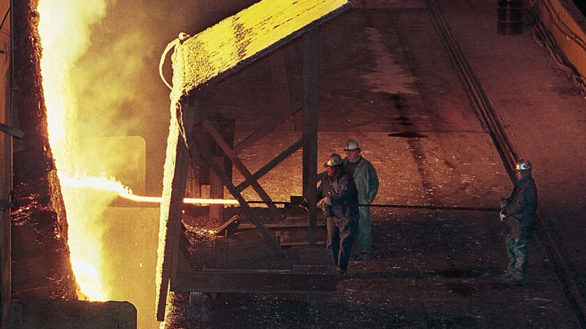 Steel workers take a sample from one of two basic oxygen furnaces at Bethlehem Steel's Sparrows Poin