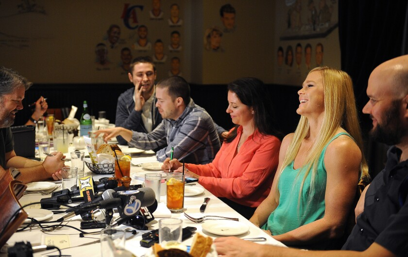 UFC bantamweight champion Holly Holm, second from right, speaks at a news conference on Feb. 22. Holm next fight will be against Miesha Tate on March 5.