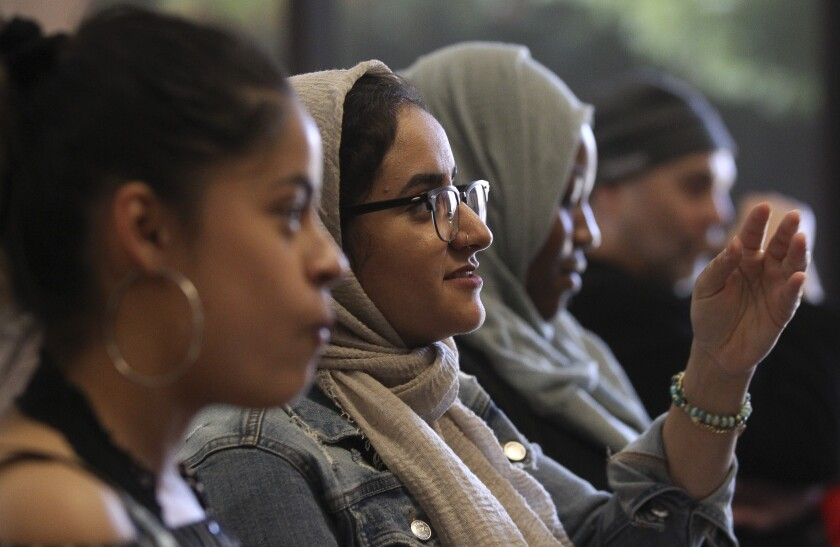 Sarah Farouq, 20, a UC Berkeley student, reacts as she and other young adults watch the Democratic presidential debate during a watch party, put on by Youth Will, at the Jacobs Center For Neighborhood Innovation on Wednesday, June 26, 2019 in San Diego, California.