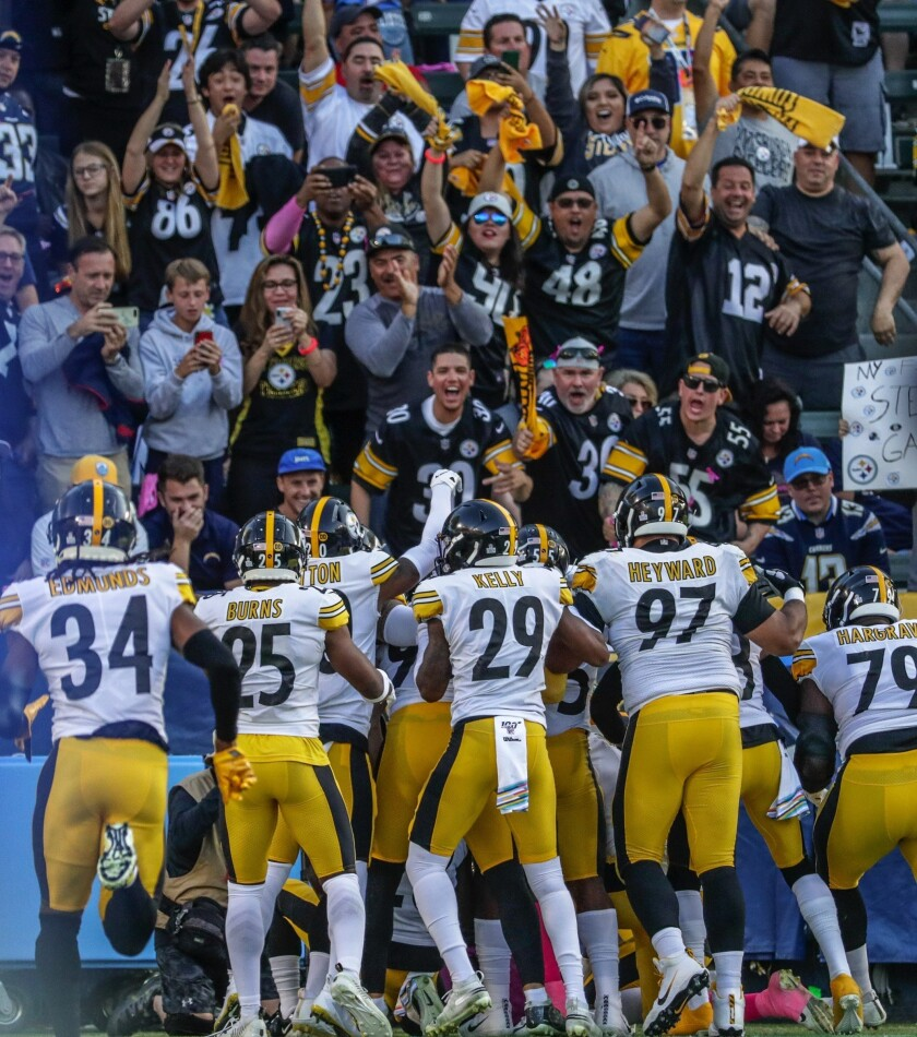 Pittsburgh players celebrate a play during last Sunday's game against the Chargers in Carson. The crowd was 80 percent Steelers fans.