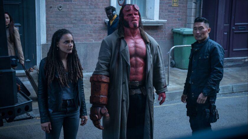 (L-R)- Alice Monaghan (Sasha Lane), Hellboy (David Harbour), and Ben Daimio (Daniel Dae Kim) in HELL