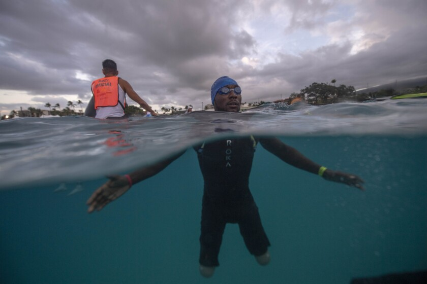Challenged triathlete Roderick Sewell at the swim start of the Ironman World Championship in Hawaii on Oct. 12. He is the first double-leg, above-knee amputee to finish the Ironman World on prosthetic legs.
