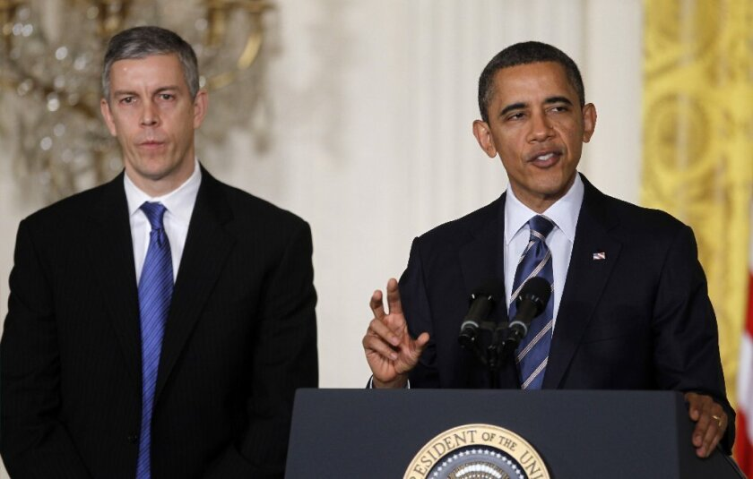 California and the Obama administration disagree on standardized testing during the state's transition to the Common Core curriculum standards. Above, President Obama is seen with U.S. Education Secretary Arne Duncan in 2012.