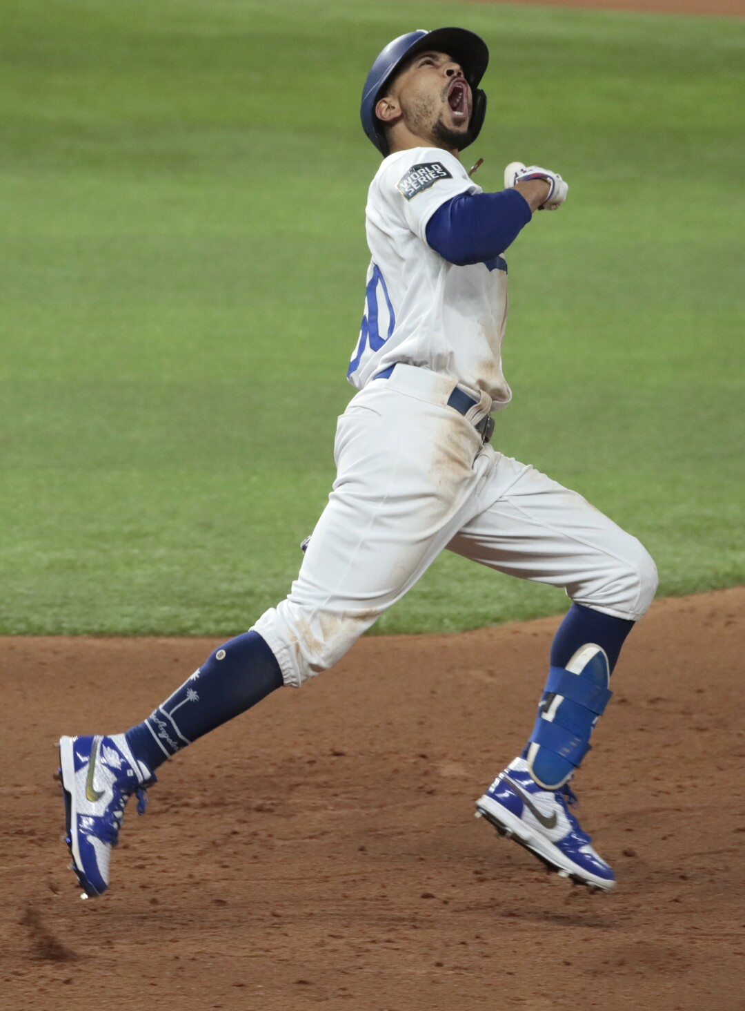 Dodgers Mookie Betts celebrates his home run in the eighth inning against the Tampa Bay Rays.