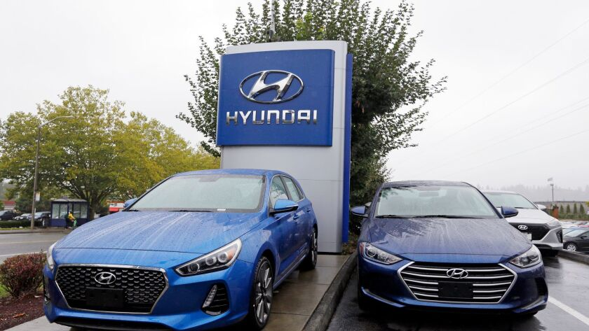 Hyundai has moved aggressively toward using online transactions to ease the often time-consuming process of buying a new car. Here, Elantra sedans wait for new owners outside a dealership in Kirkland, Wash.