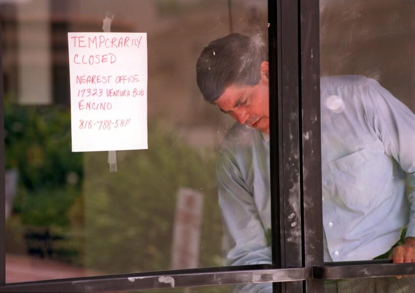 Man behind closed door at bank