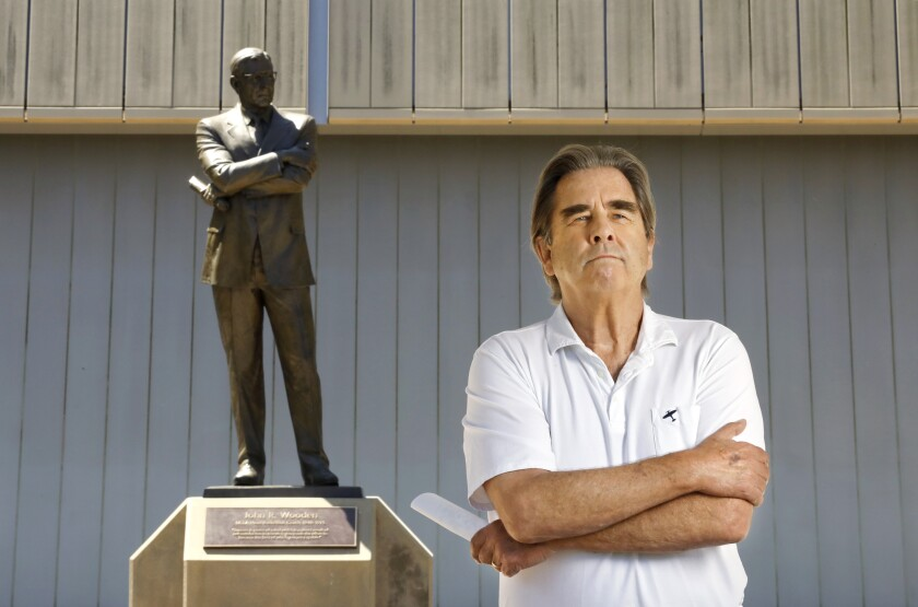 Beau Bridges, posing with the John Wooden statue at UCLA, will portray his former coach in a new play.