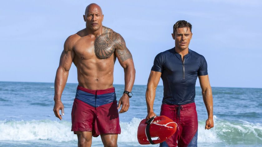 This image released by Paramount Pictures shows Dwayne Johnson as Mitch Buchannon, left, and Zac Efr