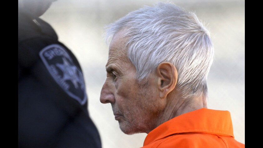 Robert Durst is escorted into prison after his arraignment in New Orleans in 2017.
