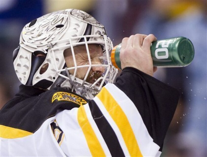 Boston Bruins goalie Tim Thomas splashes some water on his face during the third period of Game 5 of the Stanley Cup hockey finals against the Vancouver Canucks in Vancouver, British Columbia on Friday, June 10, 2011. (AP Photo/The Canadian Press, Darryl Dyck)
