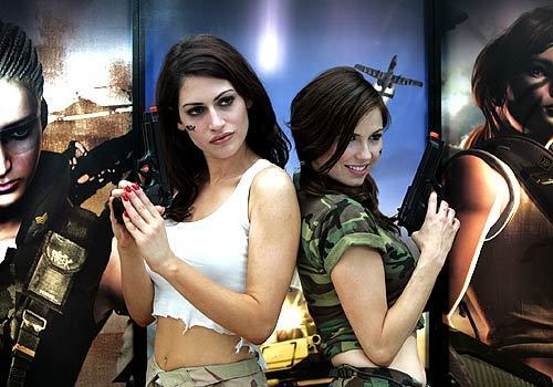 "Models Natalie Haddad, left, and Ali Costello promote K2 Network's ""War Rock"" during the Electronic Entertainment Expo at the Los Angeles Convention Center on Thursday."