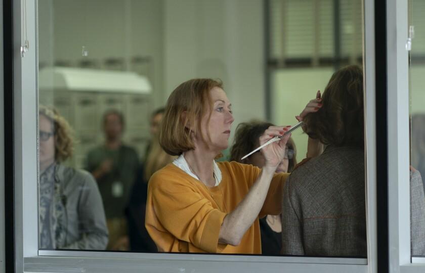Hair designer Anne Morgan on the set of