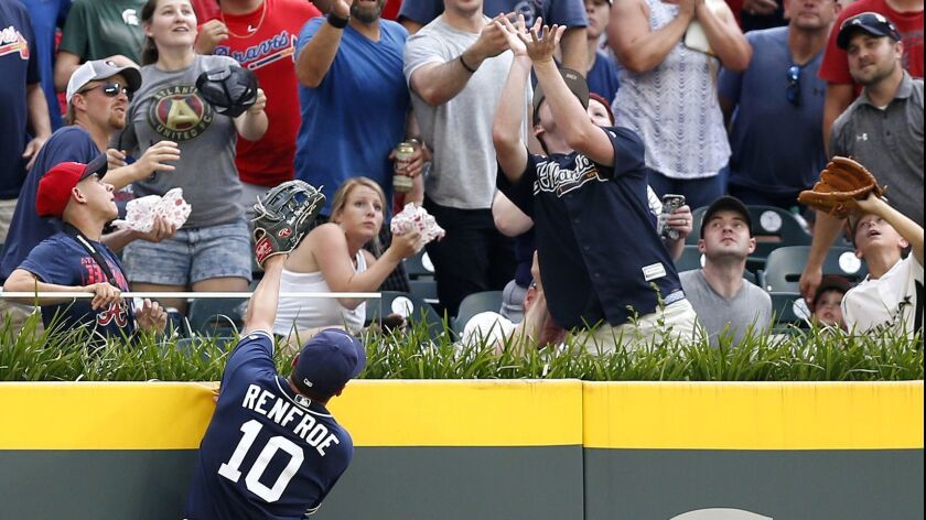 Padres left fielder Hunter Renfroe jumps but cannot get to Charlie Culberson's fourth-inning homer, the only run of Saturday's game.