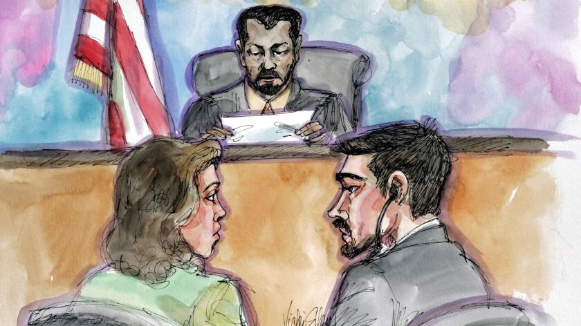 Hamid Hayat, right, and his attorney Wazhma Mojaddidi listen as U.S. District Judge Garland E. Burrell Jr. reads the jury's guilty verdict in his terror trail in a 2006 artist's sketch. A magistrate has recommended overturning Hayat's conviction.