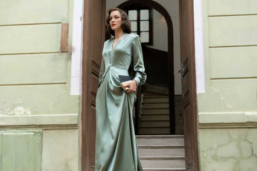 """Marion Cotillard's soft green satin gown takes the actress from goddess to assassin in """"Allied."""""""