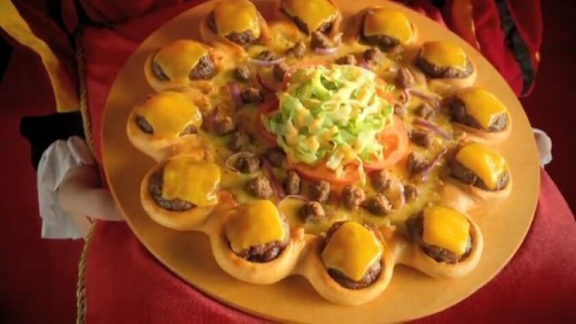 Pizza Hut's cheeseburger-ringed pizza is just one of the many innovations fast-food restaurants are trying abroad.