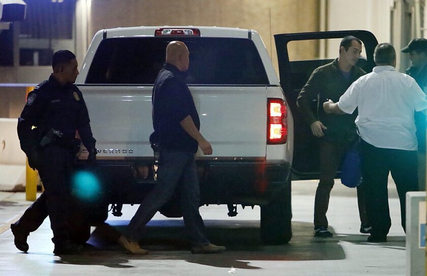 Former U.S. Marine Andrew Tahmooressi is released from Mexican custody Friday. Here Tahmooressi gets out of a pickup truck at the border to go through U.S. Customs into the United States. U-T San Diego photo by Alejandro Tamayo