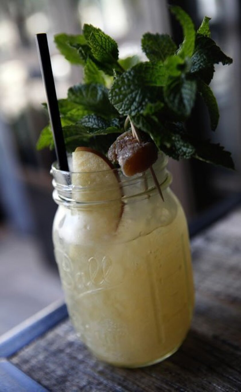 Craft & Commerce's Ginger Julep, made with Laird's apple brandy and ginger syrup, and garnished with candied-and-fresh ginger and a mint bouquet.