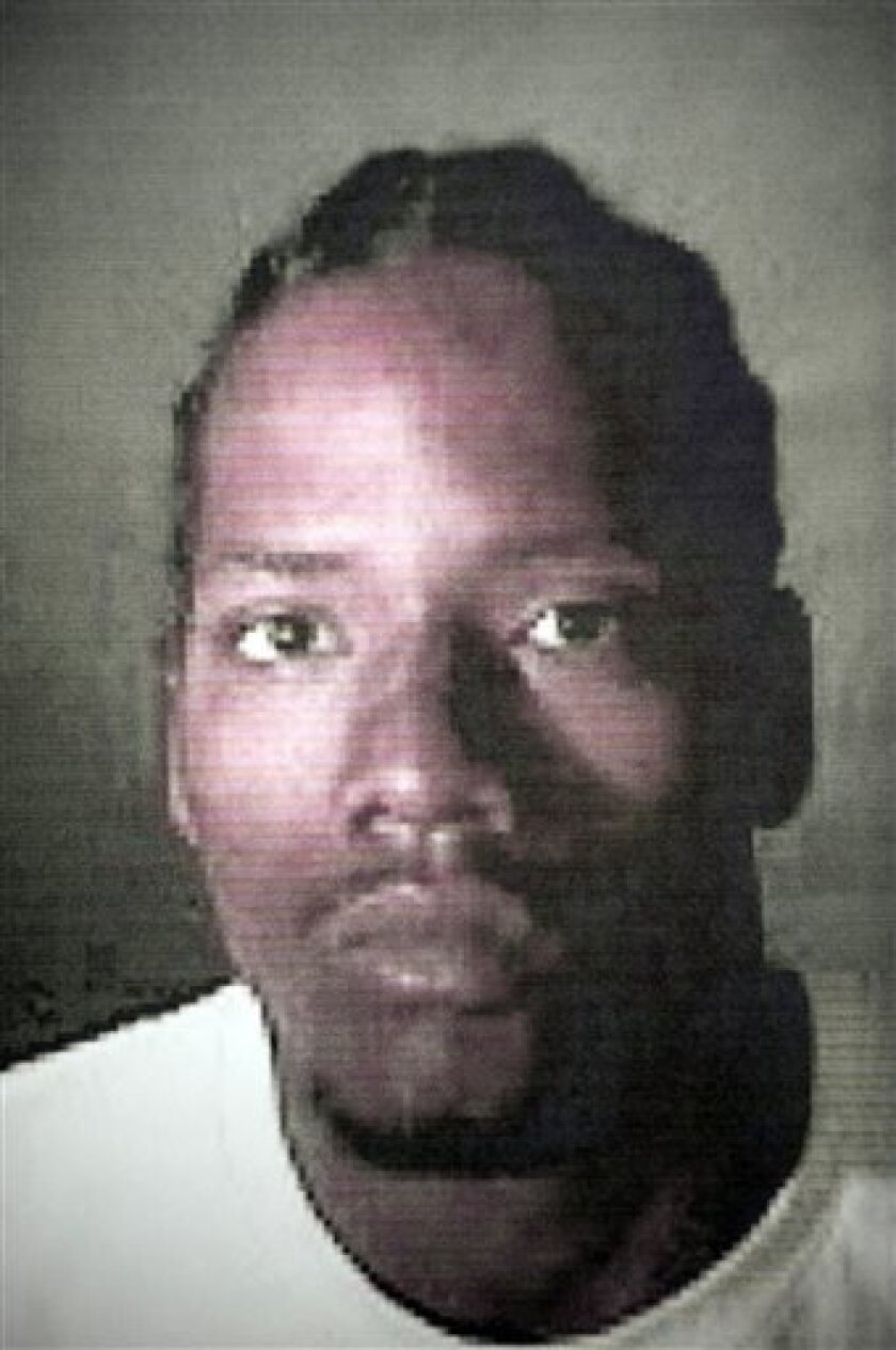 This image provided by the Los Angeles Police Department shows Leonard Hall Jr., 21, one of two members of the Kitchen Crips gang that has been booked on suspicion of the Halloween day murder of 5-year-old Aaron Shannon, Jr. in Los Angeles, Calif. (AP Photo/Los Angeles Police Department)