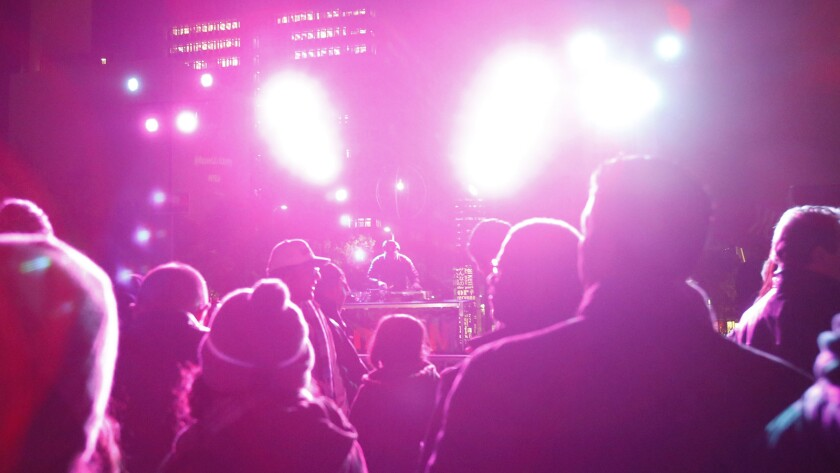 The crowd enjoys live music during the New Year's Eve celebration in Grand Park, where no alcohol was served.