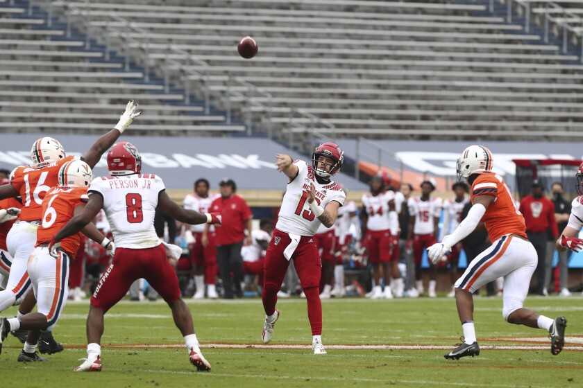 North Carolina State quarterback Devin Leary (13) throws a pass against Virginia during an NCAA college football game, Saturday, Oct. 10, 2020, at Scott Stadium in Charlottesville, Va. (Erin Edgerton/The Daily Progress via AP)
